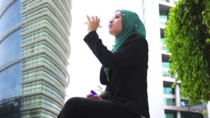 muslim woman drinking water