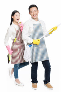 couple mopping and doing housework