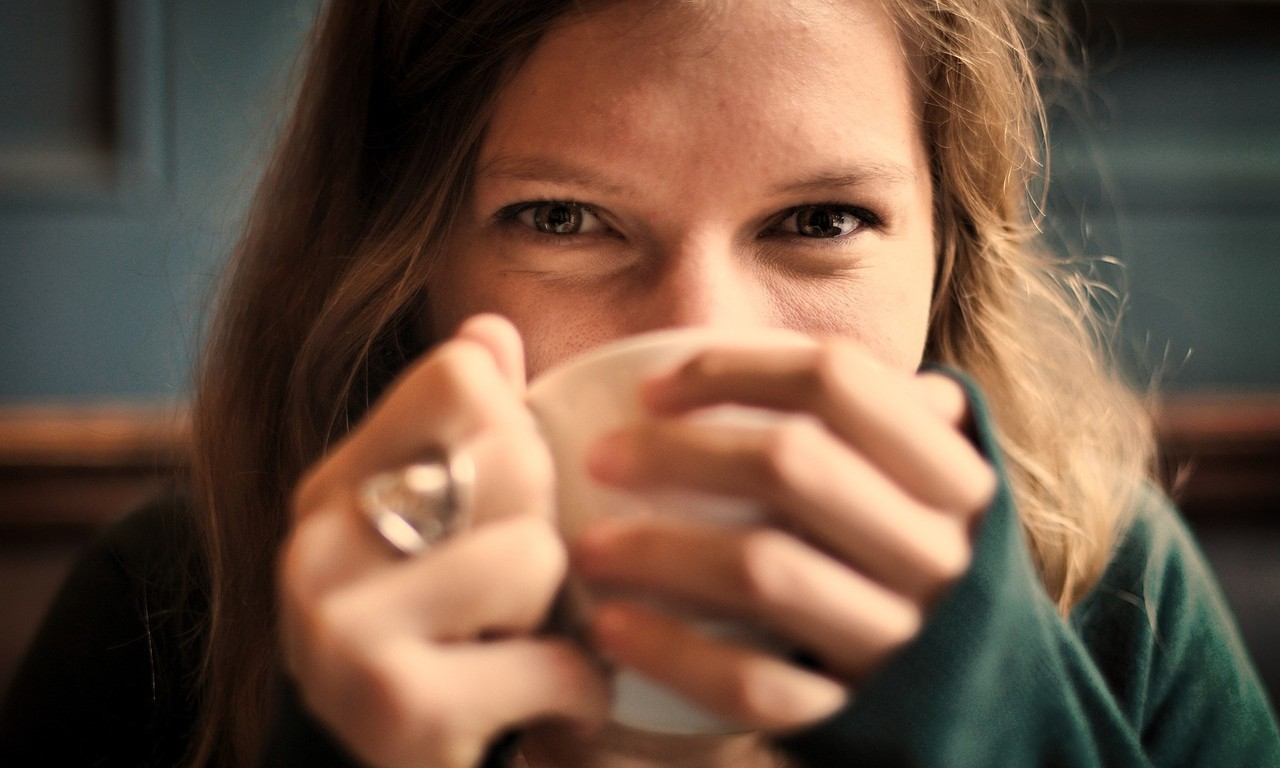 girl smiling drinking tea